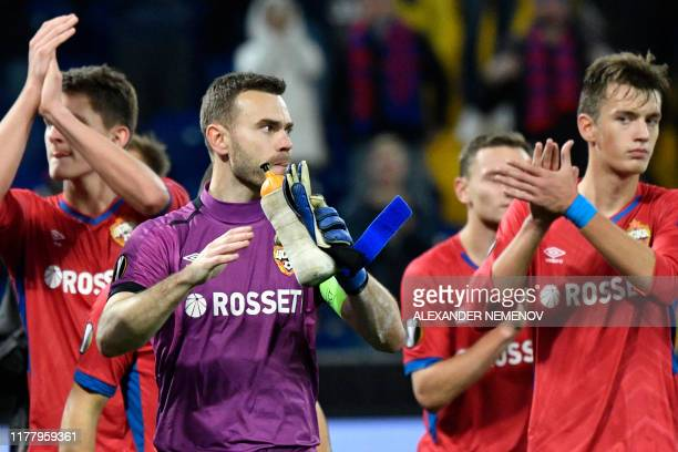Moscow's Russian goalkeeper Igor Akinfeev and other players thank supporters after the UEFA Europa League Group H football match between CSKA Moscow...