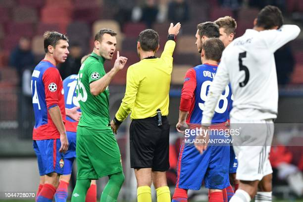 Moscow's Russian goalkeeper Igor Akinfeev argues with the referee during the UEFA Champions League group G football match between PFC CSKA Moscow and...