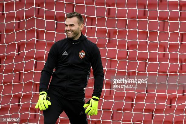 Moscow's Russian goalkeeper Igor Akinfeev attends a training session on the eve of their UEFA Europa League first leg quarterfinal football match...