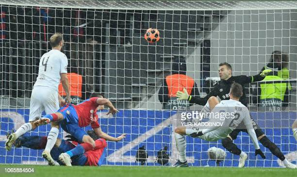 Moscow's Russian goalkeeper Igor Akinfeev concedes a goal during the UEFA Champions League group G football match between PFC CSKA Moscow and FC...