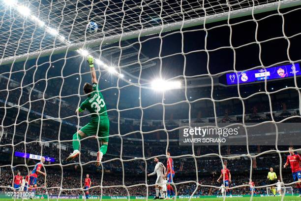 Moscow's Russian goalkeeper Igor Akinfeev dives for the ball during the UEFA Champions League group G football match between Real Madrid CF and CSKA...