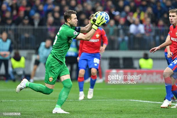 Moscow's Russian goalkeeper Igor Akinfeev grabs the ball during the UEFA Champions League group G football match between PFC CSKA Moscow and Real...