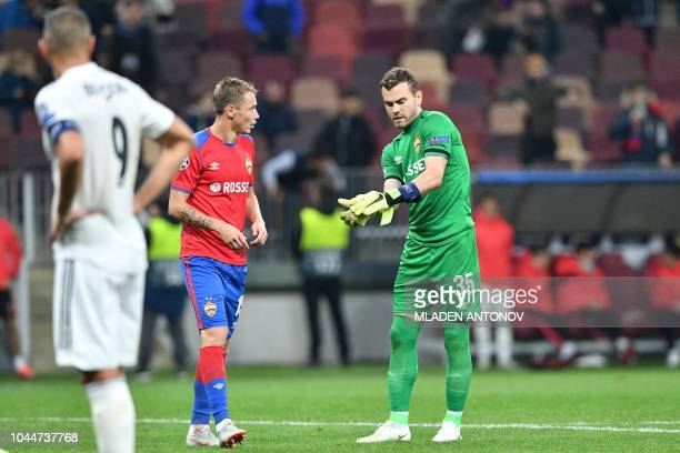 Moscow's Russian goalkeeper Igor Akinfeev leaves the pitch after being given a red card during the UEFA Champions League group G football match...