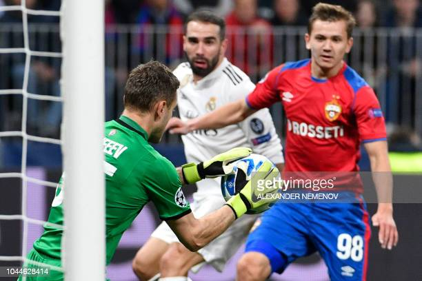 Moscow's Russian goalkeeper Igor Akinfeev makes a save during the UEFA Champions League group G football match between PFC CSKA Moscow and Real...
