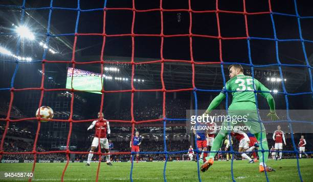 Moscow's Russian goalkeeper Igor Akinfeev misses to save his net during the UEFA Europa League second leg quarterfinal football match between CSKA...