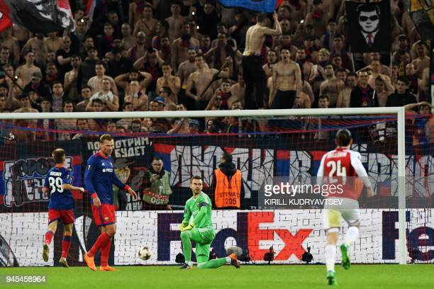 Moscow's Russian goalkeeper Igor Akinfeev reacts after Arsenal's scored a goal during the UEFA Europa League quarter final second leg football match...