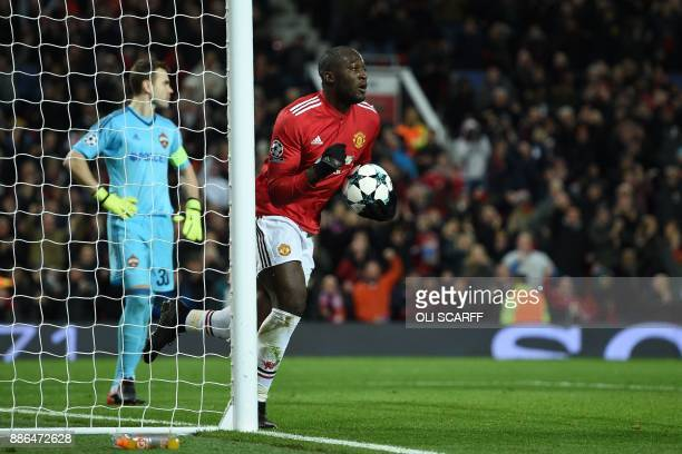 Moscow's Russian goalkeeper Igor Akinfeev reacts as Manchester United's Belgian striker Romelu Lukaku celebrates scoring their first goal during the...