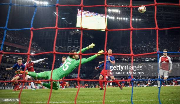 Moscow's Russian goalkeeper Igor Akinfeev saves his net during the UEFA Europa League second leg quarterfinal football match between CSKA Moscow and...