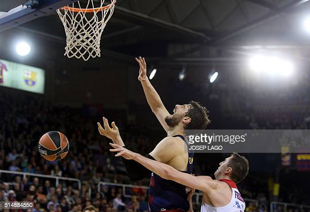 Moscow's Russian guard Vitaly Fridzon vies with Barcelona's Croatian center Ante Tomic during the Euroleague group F top 16 round 10 basketball match...