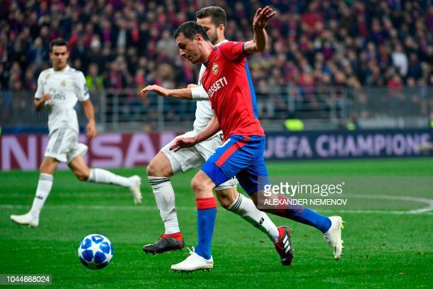 Moscow's Russian midfielder Alan Dzagoev and Real Madrid's Spanish defender Nacho Fernandez vie for the ball during the UEFA Champions League group G...
