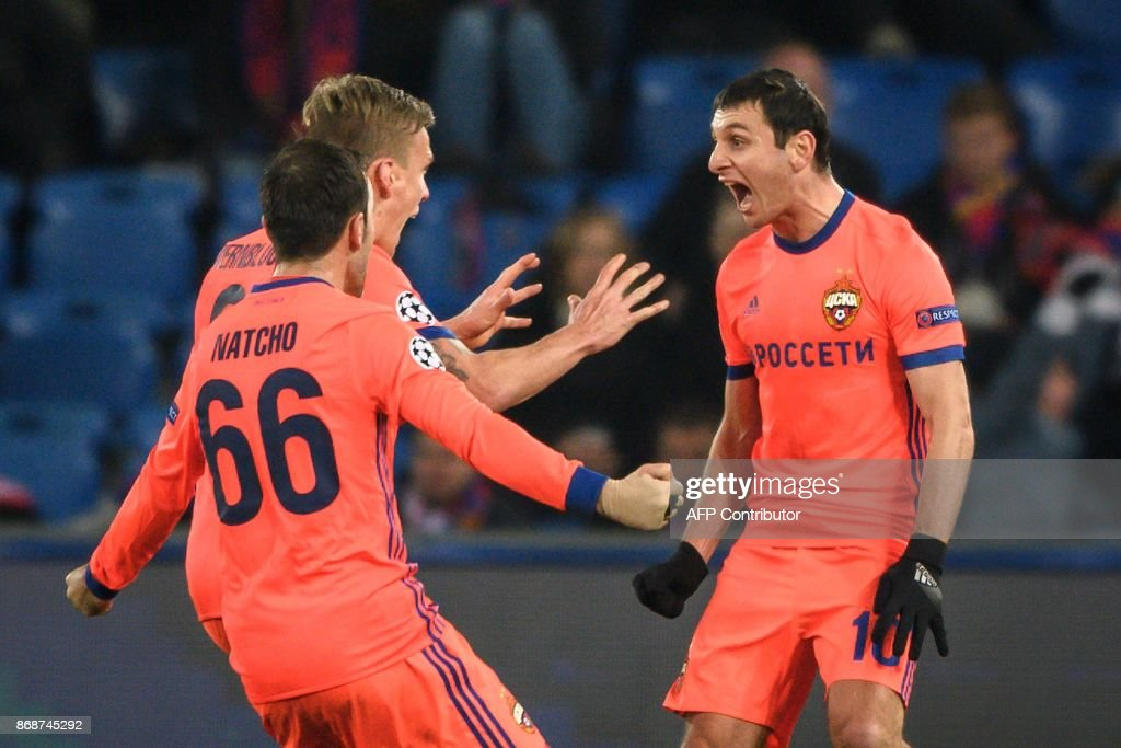 Moscow's Russian midfielder Alan Dzagoev (R) celebrates with teammates after scoring a goal during the UEFA Champions League Group A football match between FC Basel and CSKA Moscow at Saint Jakob-Park Stadium on October 31, 2017 in Basel. / AFP PHOTO / Fabrice COFFRINI