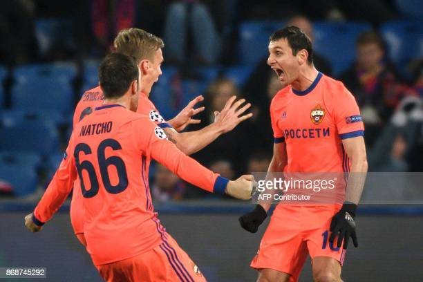 Moscow's Russian midfielder Alan Dzagoev celebrates with teammates after scoring a goal during the UEFA Champions League Group A football match...