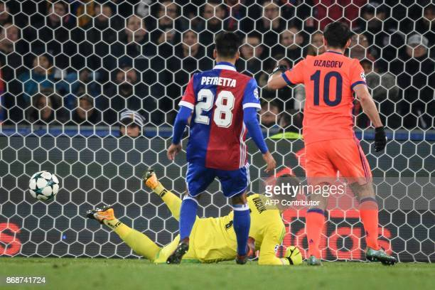Moscow's Russian midfielder Alan Dzagoev scores a goal against Basel's Czech goalkeeper Tomas Vaclik during the UEFA Champions League Group A...