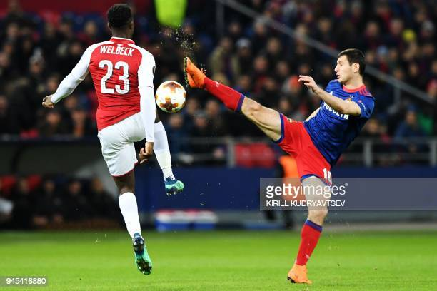 Moscow's Russian midfielder Alan Dzagoev vies Arsenal's English striker Danny Welbeck during the UEFA Europa League second leg quarterfinal football...