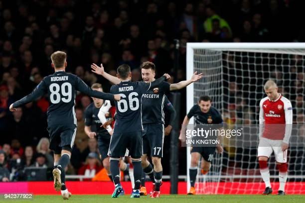 Moscow's Russian midfielder Aleksandr Golovin celebrates with teammates after scoring their first goal during the UEFA Europa League first leg...