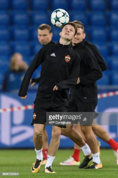 Moscow's Russian midfielder Aleksandr Golovin plays with a ball during a training session on the eve of the UEFA Champions League Group A football...