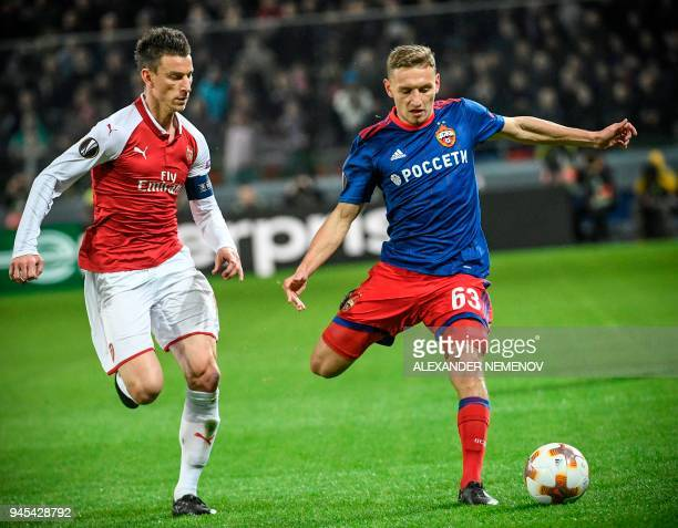Moscow's Russian striker Fedor Chalov vies with Arsenal's Spanish defender Hector Bellerin during the UEFA Europa League second leg quarterfinal...