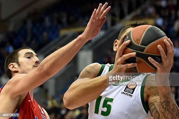 Moscow's Serbien forward Nando De Colo fights for the ball with Panathinaikos Athens' Uruguay center Esteban Batista during their Euroleague...