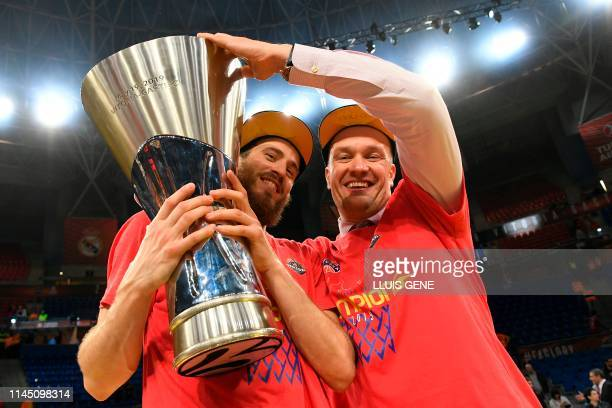 Moscow's Spanish guard Sergio Rodriguez and CSKA Moscow president Andrey Vatutin hold the trophy after winning the EuroLeague final basketball...