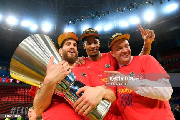 Moscow's Spanish guard Sergio Rodriguez CSKA Moscow's US forward Will Clyburn and CSKA Moscow president Andrey Vatutin hold the trophy after winning...