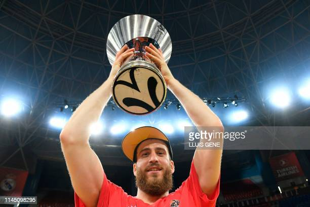 Moscow's Spanish guard Sergio Rodriguez holds the trophy after winning the EuroLeague final basketball against Anadolu Efes at the Fernando Buesa...