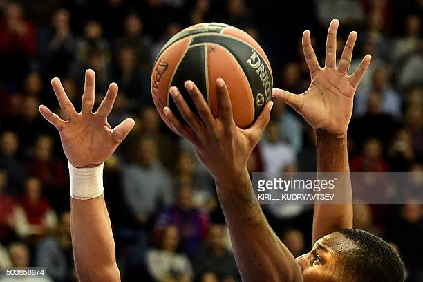 Moscow's US forward Demetris Nichols vies with Real Madrid's Mexican center Gustavo Ayon and Real Madrid's Trey Thompinks during their Euroleague Top...