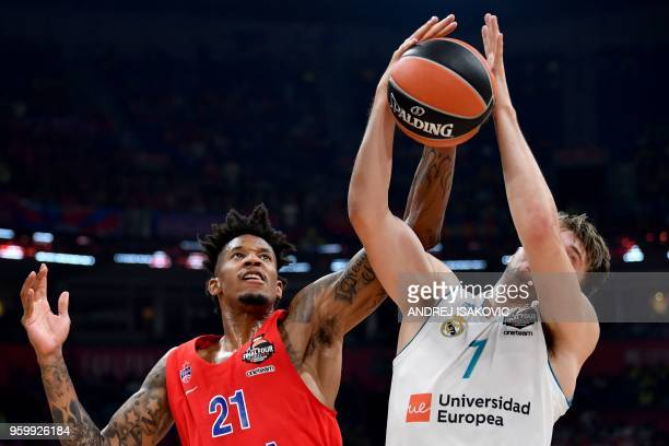 Moscow's US forward Will Clyburn fights for the ball with Real Madrid's Slovenian Luka Doncic during the Euroleague Final Four second semi-final...