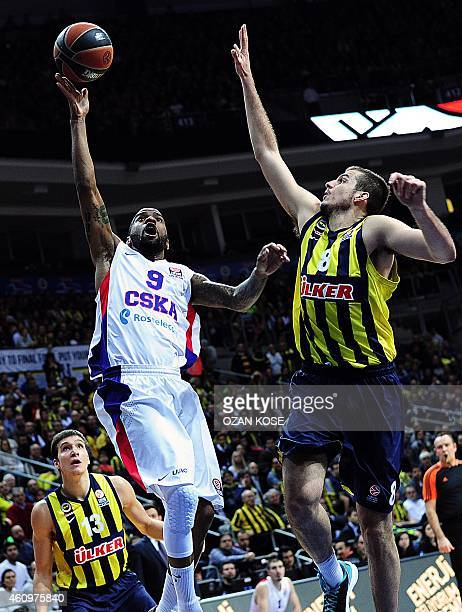 Moscow's US guard Aaron Jackson vies for the ball with Fenerbahce Ulker's Serbian forward Nmanja Bjelica and Serbian forward Bogdan Bogdanovic during...
