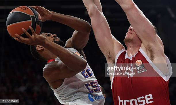 Moscow's US guard Cory Higgins and Bamberg's Croatian center Leon Radosevic vie for the ball during the EuroLeague Top 16 Group F basketball match...