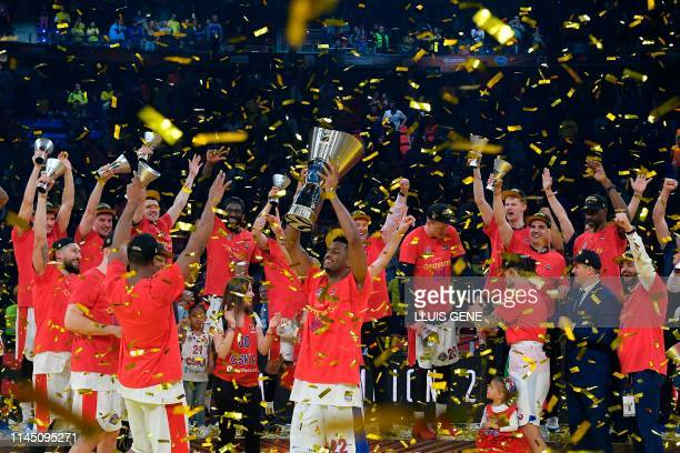 Moscow's US guard Cory Higgins holds the trophy as he celebrates with teammates after winning the EuroLeague final basketball against Anadolu Efes at...