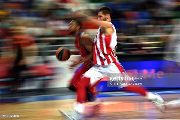 Moscow's US guard Cory Higgins vies with Crvena Zvezda's guard Stefan Jovic during the Euroleague playoff game 2 basketball match between CSKA Moscow...