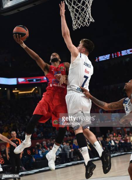 Moscow's US guard Cory Higgins vies with Real Madrid's Slovenian guard Luka Doncic and Swedish forward Jeffery Taylor during the third place...