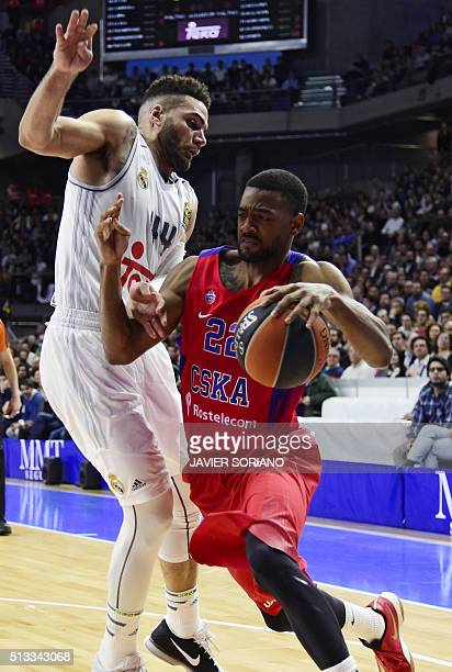 Moscow's US guard Cory Higgins vies with Real Madrid's Swedish forward Jeffery Taylor during the Euroleague top 16 group E round 9 basketball match...