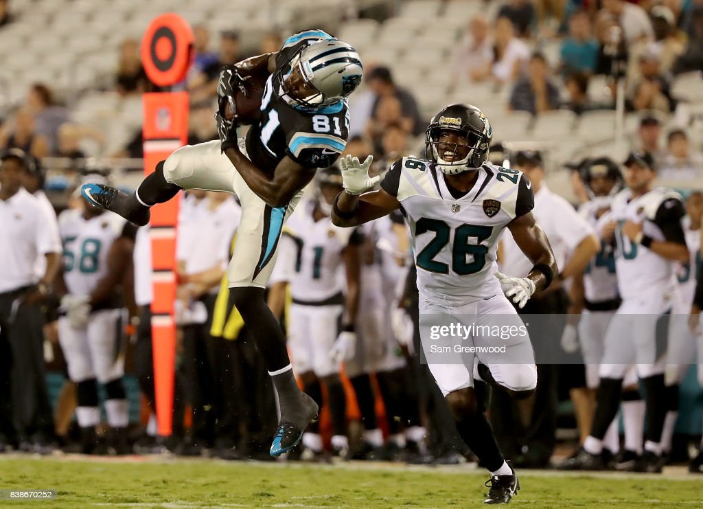 Mose Frazier #81 of the Carolina Panthers makes a reception against Doran Grant #26 of the Jacksonville Jaguars during a preseason game at EverBank Field on August 24, 2017 in Jacksonville, Florida.