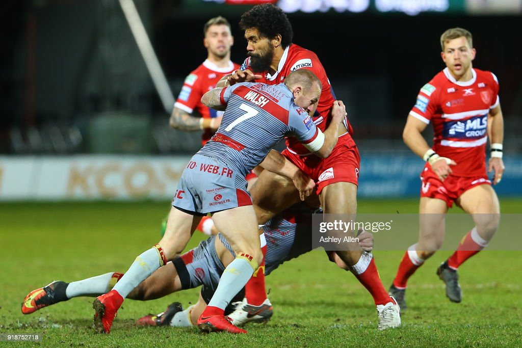 Mose Masoe of Hull KR is tackled by Luke Walsh and Benjamin Garcia of the Catalans Dragons during the BetFred Super League match between Hull KR and Catalans Dragons at KCOM Craven Park on February 15, 2018 in Hull, England.