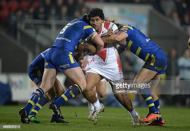 Mose Masoe of St Helens is tackled by Ashton Sims and Chris Hill of Warrington Wolves during the First Utility Super League match between St Helens...