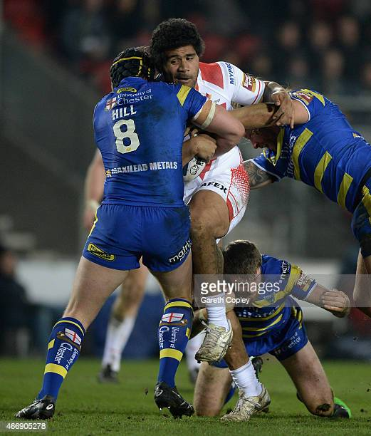 Mose Masoe of St Helens is tackled by Ashton Sims Daryl Clark and Chris Hill of Warrington Wolves during the First Utility Super League match between...