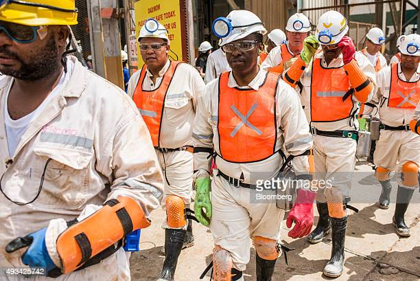 Mosebenzi Zwane South Africa's Mineral Resources Minister right tours Harmony Gold Mining Co's Doornkop mine west of Johannesburg South Africa on...
