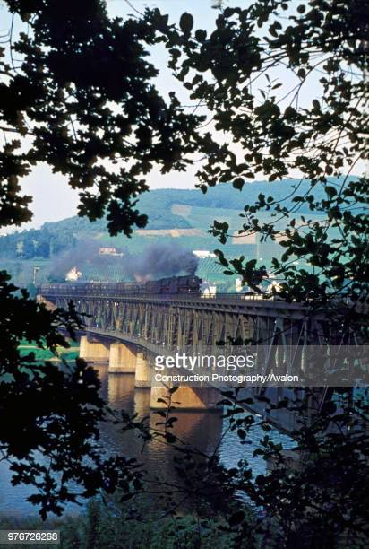 Mosel Valley Line A pair of German Railway's circa 144 3 cylinder 2100s cross the river Mosel at Valley with a rake of coal hoppers circa 1970