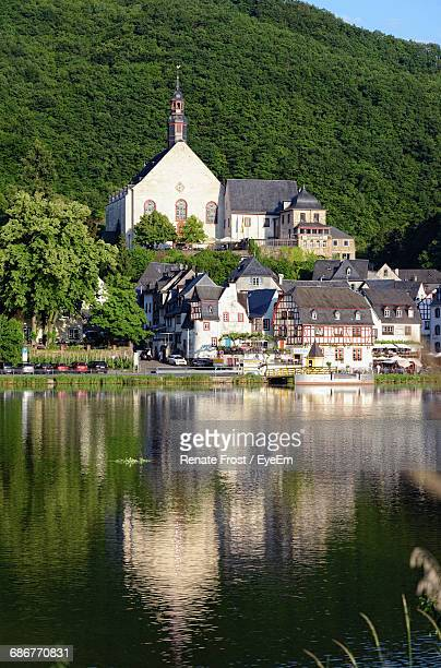 Moselle River Against Buildings And Mountain