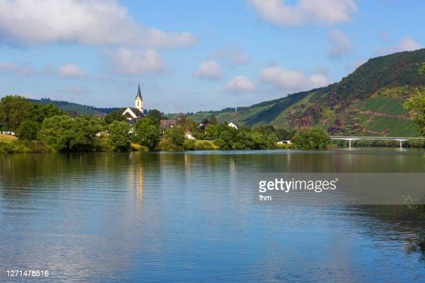 moselle river with old church (germany) - moselle stock-fotos und bilder