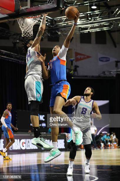 Moses Brown of the Oklahoma City Blue goes to the basket against the Greensboro Swarm on February 24, 2021 at HP Field House in Orlando, Florida....