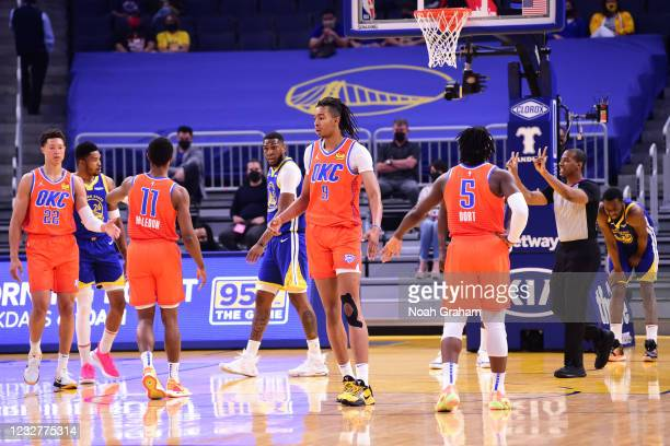 Moses Brown of the Oklahoma City Thunder high fives teammates during the game against the Golden State Warriors on April 8, 2021 at Chase Center in...