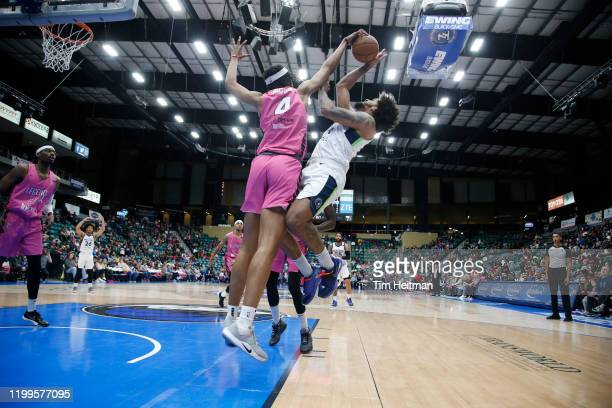 Moses Brown of the Texas Legends blocks the shot of Jordan Murphy of the Iowa Wolves during the first quarter on February 08 2020 at Comerica Center...