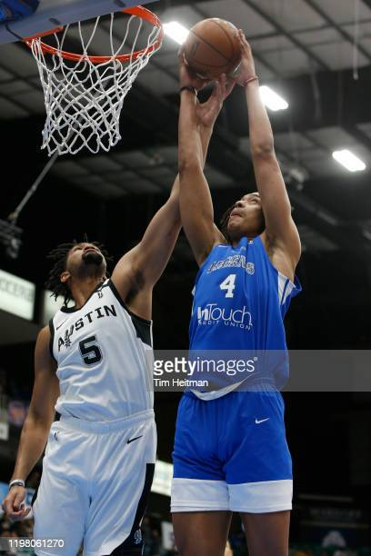 Moses Brown of the Texas Legends grabs a rebound against Dedric Lawson of the Austin Spurs during the third quarter on February 01 2020 at Comerica...