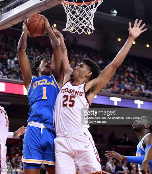 Moses Brown of the UCLA Bruins drives to th basket against Bennie Boatwright of the USC Trojans in the second half of a NCAA basketball game at the...