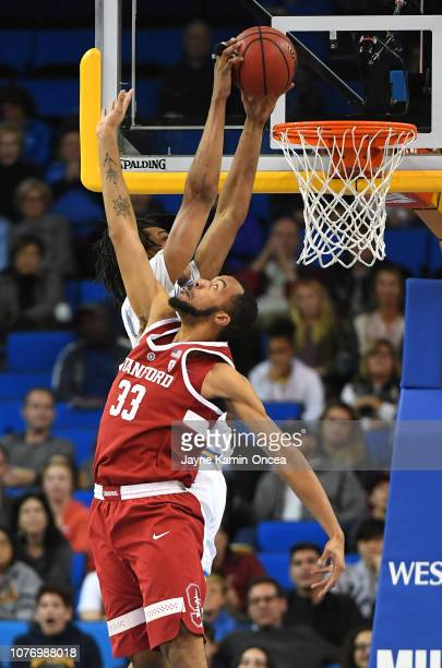 Moses Brown of the UCLA Bruins dunks over Trevor Stanback of the Stanford Cardinal in the second half of the game at Pauley Pavilion on January 3...