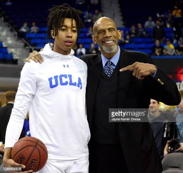 Moses Brown of the UCLA Bruins gets words of advice from former NBA and UCLA Bruin Kareem AbdulJabbar before the game against the Arizona Wildcats at...