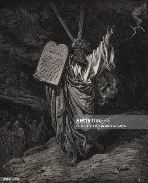 Moses comes down from the Sinai with the tablets of law in his hand engraving by Gustave Dore from The Holy Scriptures containing the Old and New...