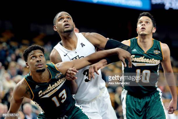 Moses Greenwood and Eddy Polanco of the Southeastern Louisiana Lions block out AJ Davis of the UCF Knights during a NCAA basketball game at the CFE...